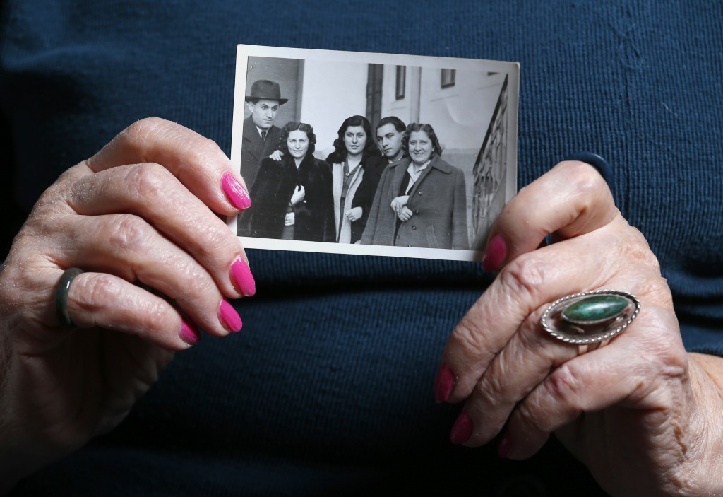 Auschwitz death camp survivor Erzsebet Brodt holds a picture of her family, who were all killed in the concentration camp during World War II