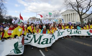 Thousands participate in the anti-abortion March for Life past the U.S. Supreme Court building in Washington