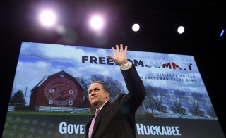 Former Governor of Arkansas Mike Huckabee waves after speaking at the Freedom Summit in Des Moines