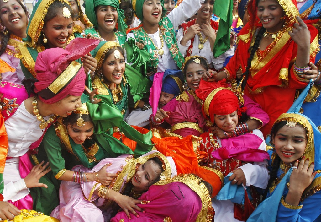 School children celebrate after winning the best cultural performance trophy during the Republic Day celebrations in the northern Indian city of Chandigarh. India celebrated its 66th Republic Day on Monday. Photo by Ajay Verma/Reuters