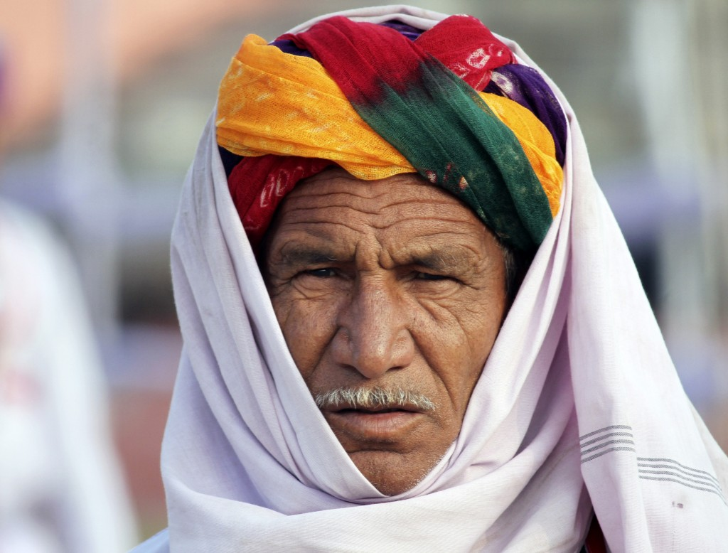 An artist wearing a traditional headgear waits to perform in the Republic Day parade in the northern Indian city of Ajmer Monday. Photo by Himanshu Sharma/Reuters