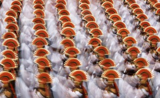 Indian soldiers march during the Republic Day parade in New Delhi Monday. President Barack Obama watched the dazzling parade of India's military might and cultural diversity, the second day of a visit trumpeted as a chance to establish a robust strategic partnership between the world's two largest democracies. Photo by Adnan Abidi/Reuters