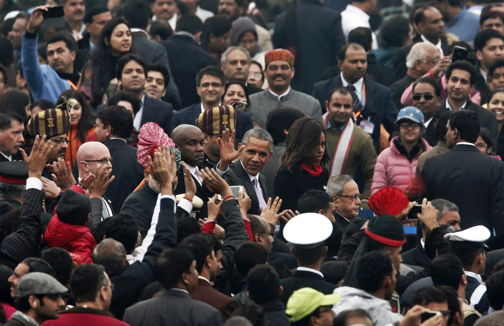 President Barack Obama, with first lady Michelle Obama, waves after attending the Republic Day parade in New Delhi. Photo by Adnan Abidi/Reuters