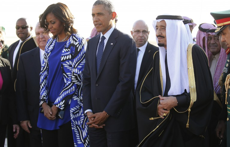 U.S. President Obama and first lady Michelle are greeted by Saudi Arabia's King Salman as they arrive at King Khalid International Airport in Riyadh