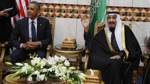 Saudi Arabia's King Salman gestures to the media as he sits with U.S. President Obama at Erga Palace in Riyadh
