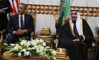 Photo by Jim Bourg/Reuters Saudi Arabia's King Salman gestures to the media as he sits with U.S. President Barack Obama at Erga Palace in Riyadh, Jan. 27. A court testimony by Zacharias Moussaoui, a former al-Qaida member serving life in federal prison, has renewed questions of a link between the government of Saudi Arabia and the Sept. 11 terrorist attacks. While some American officials urge for the release of 28 pages of classified documents relating to Saudi Arabia from a joint congressional inquiry into the attacks, others say no such link exists and making the material public would serve no purpose.