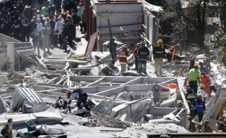 Emergency responders work at the site of an explosion at a maternity hospital in Mexico City Thursday. The explosion rocked the hospital west of Mexico City when a leak from a gas truck ignited, destroying a large part of the building and killing at least two people. Photo by Edgard Garrido/Reuters