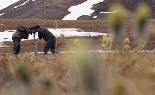 Matthew Wallenstein, an ecologist from Colorado State University, and his team are drilling into the Alaskan tundra. They are studying soil samples for answers to how the warming tundra will increase global warming. Courtesy: National Science Foundation/Science Nation