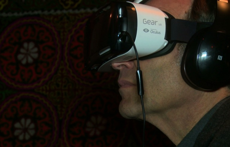 Chief arts correspondent Jeffrey Brown dons a virtual reality headset at the New Frontier exhibition at the Sundance Film Festival