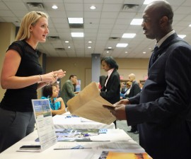 NEW YORK, NY - JUNE 11:  An applicant (R), speaks with a prospective employer at a job fair on June 11, 2012 in New York City. Some 400 arrived early for the event held by National Career Fairs, and up to 1,000 people were expected by the end of the day.  (Photo by John Moore/Getty Images)