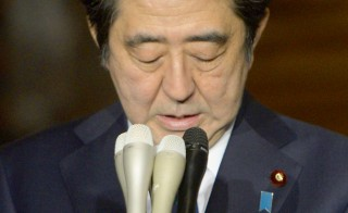 Japan's Prime Minister Shinzo Abe speaks to the media at his official residence in Tokyo in this January 25, 2015 photo by Kyodo. Abe expressed anger early on Sunday at a video purporting to show the execution of a Japanese citizen by Islamic State militants, and insisted Tokyo will not bow to terrorism. Photo by REUTERS/Kyodo