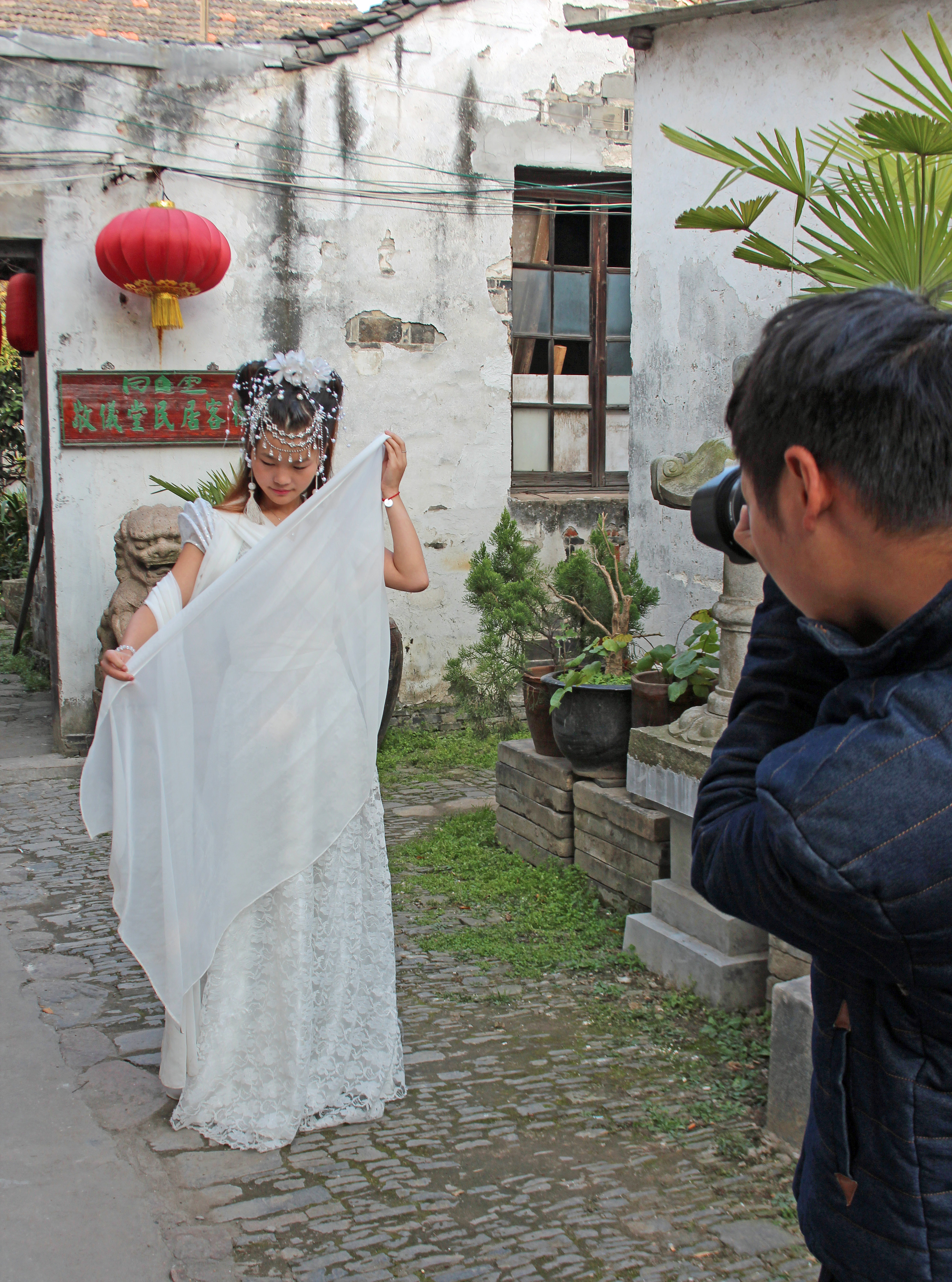 The alleyways of Tongli town in China serve as a backdrop for a bridal photo shoot. Photo by Larisa Epatko/PBS NewsHour