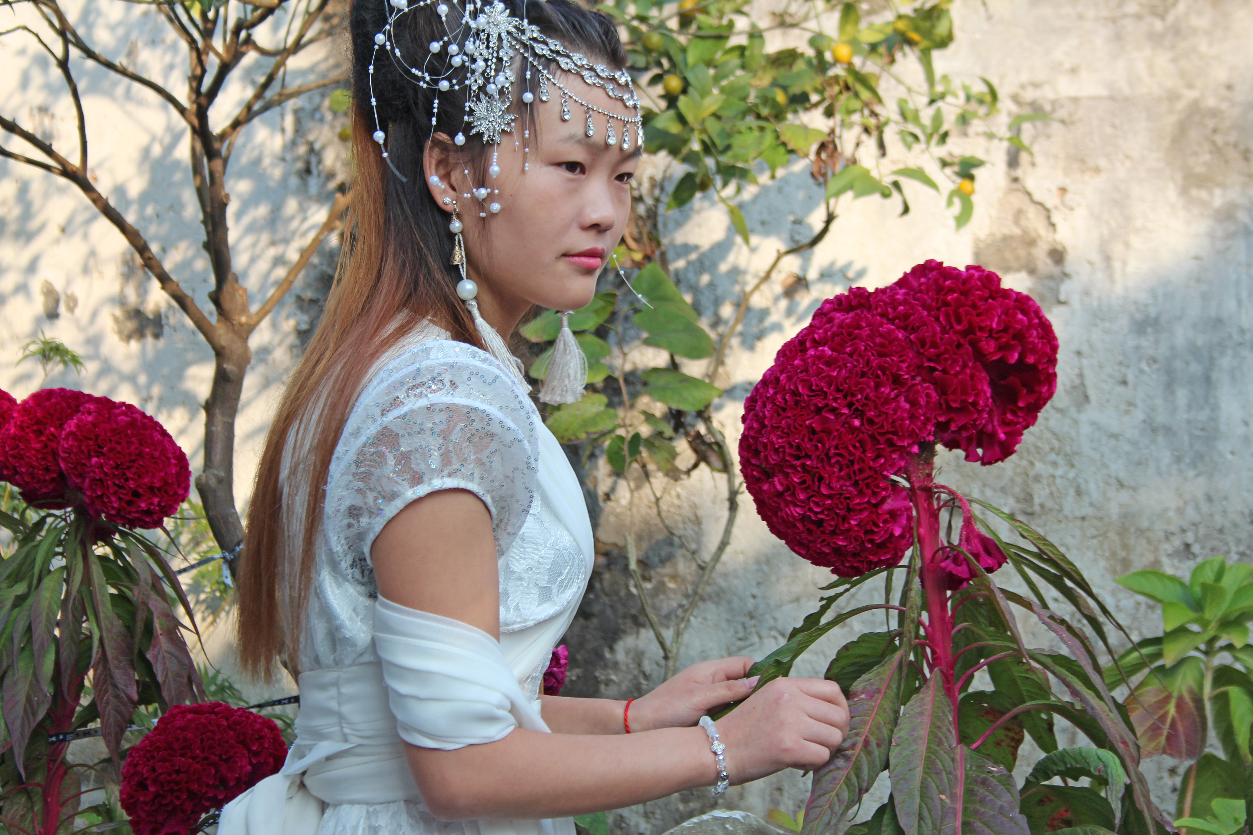 A bride poses among flowers in Tongli, a preserved ancient village in eastern China. Photo by Larisa Epatko/PBS NewsHour