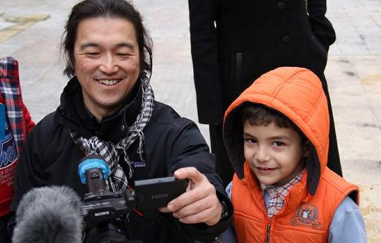"Japanese journalist Kenji Goto working in the field. Photo courtesy of ""I am Kenji"" Facebook page"