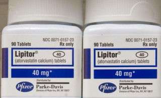 Bottles of the Pfizer cholesterol drug Lipitor sit on a shelf in a Boston, Massachusetts pharmacy Monday, December 19, 2005. Shares of Pfizer Inc. rose as much as 12 percent, the most in at least 25 years, after a U.S. court ruling blocked generic competition until 2011 for Lipitor, the world's best-selling prescription drug. Photo by Jb Reed/Bloomberg via Getty Images)