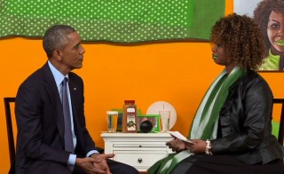 President Barack Obama speaks with GloZell Green.