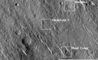 This annotated image shows where features seen in an observation by NASA's Mars Reconnaissance Orbiter have been interpreted as hardware from the Dec. 25, 2003, arrival at Mars of the United Kingdom's Beagle 2 Lander. The image was taken in 2014 by the orbiter's HiRISE camera. Image courtesy of NASA/JPL-Caltech/Univ. of Arizona/University of Leicester