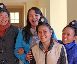 Lu Thi Thanh (middle, blue coat) is one of the core members of the Sunflower support group for women with HIV. Photo by Larisa Epatko/PBS NewsHour