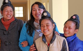 Lu Thi Thanh (middle, blue coat) is one of the core members of the Sunflower support group for women with HIV in Vietnam. Photo by Larisa Epatko/PBS NewsHour
