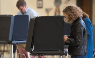 Voters cast electronic votes during the