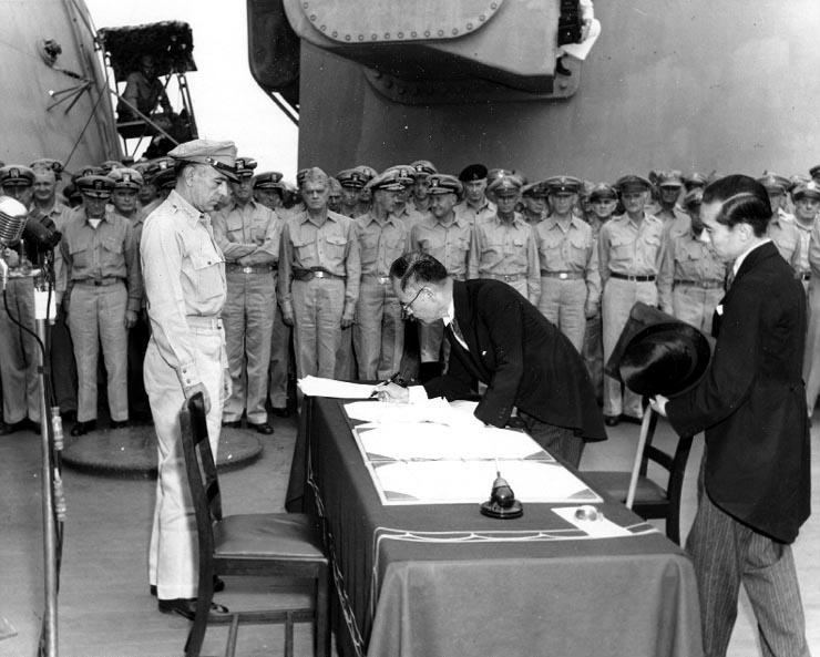 Foreign Minister Mamoru Shigemitsu signs the Instrument of Surrender on behalf of the Japanese Government during formal surrender ceremonies on the USS MISSOURI in Tokyo Bay, September 2, 1945. Photo courtesy of Army Signal Corps.