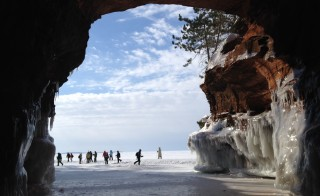 Visitors in 2014 making the trek across Lake Superior to get to the ice caves. Photo by Flickr user pixn8tr.