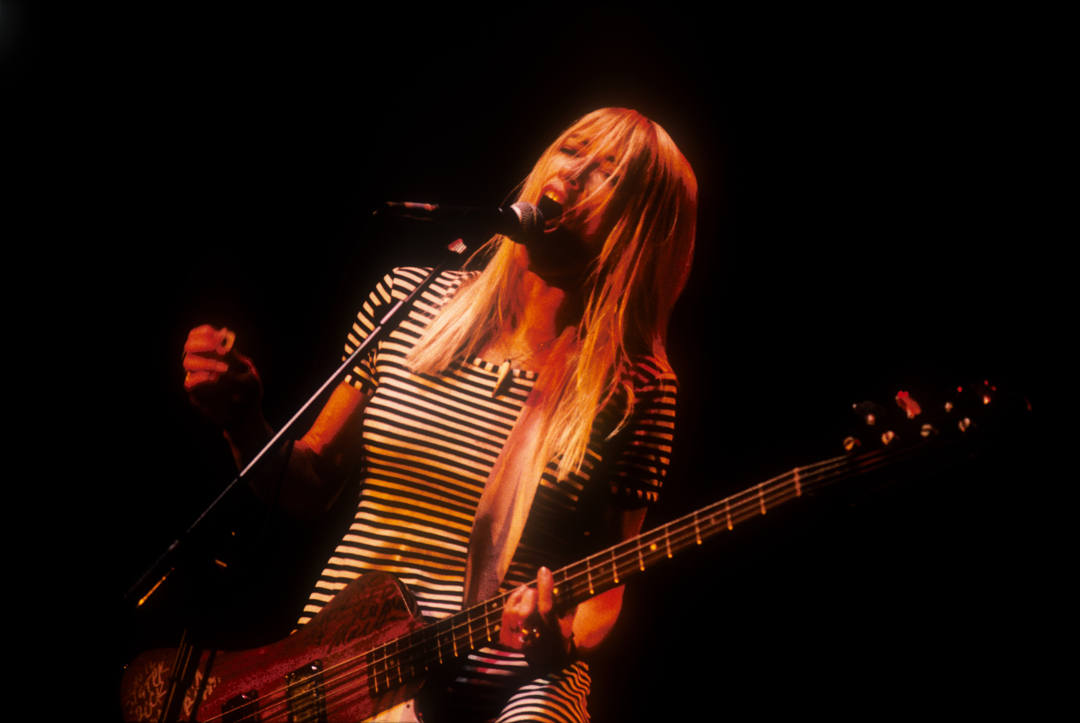 Kim Gordon and Sonic Youth performing live in London in 1990. Photo by Alastair Indge/Photoshot/Getty Images