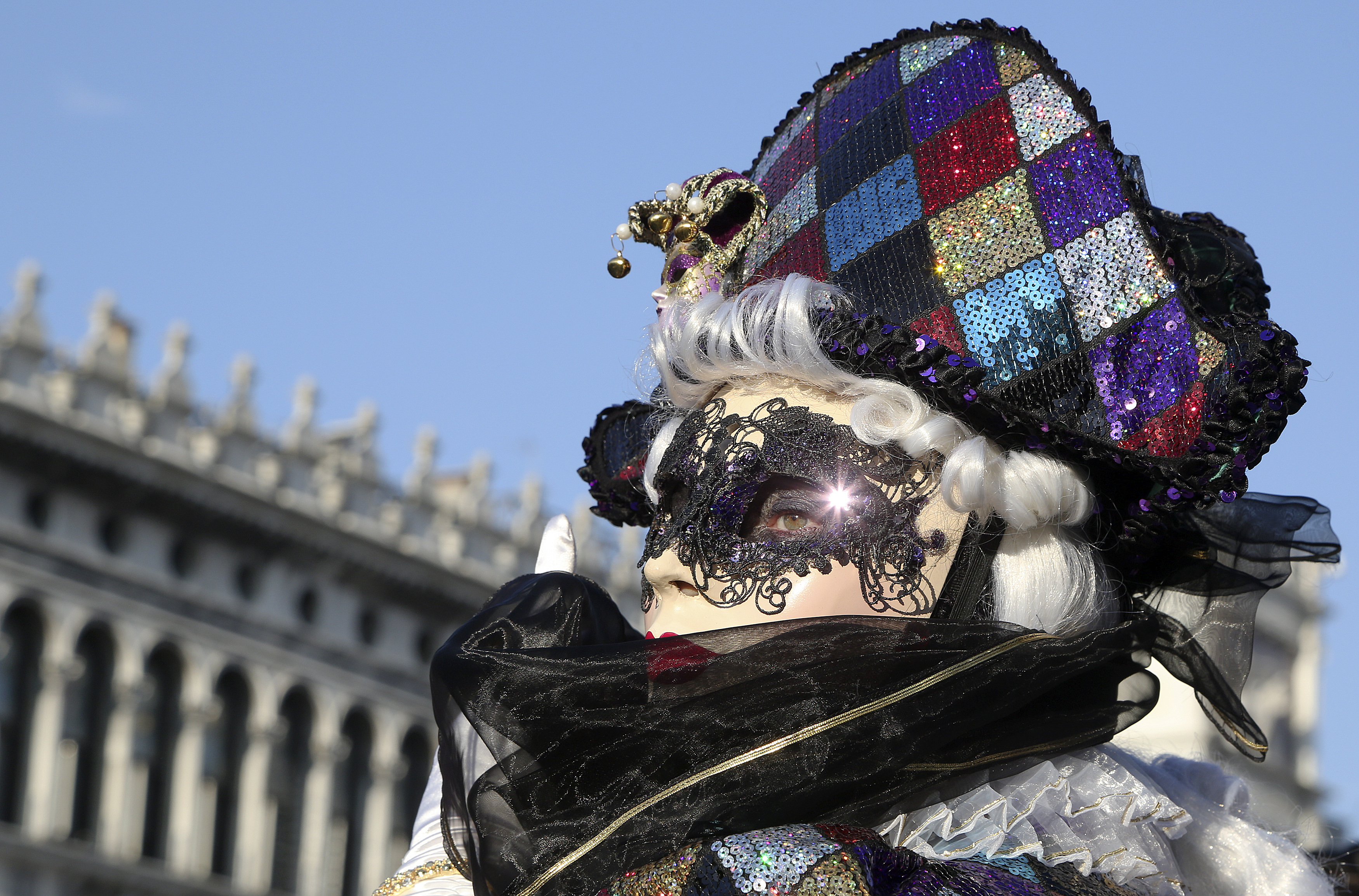 A masked reveler poses at Saint Mark's square during Carnival in Venice, February 8, 2015. Photo by Stefano Rellandini/REUTERS.
