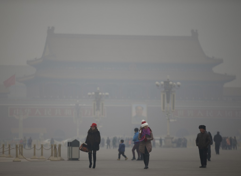 Photo by Kim Kyung-Hoon/Reuters Visitors take a walk during a polluted day at Tiananmen Square in Beijing Jan. 15, 2015. According to data by the World Health Organization last year, New Delhi now surpasses Beijing as the city with the worst air pollution in the world.