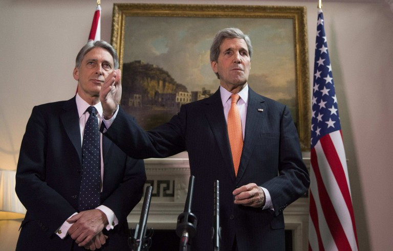 Britain's Foreign Secretary Phillip Hammond and U.S. Secretary of State John Kerry (R) deliver a statement at a press conference in London, February 21, 2015. The U.S. and Great Britain discussed imposing new further sanctions on Russia as the rebel attacks in Ukraine continue despite a cease-fire agreement Photo by Neil Hall/Reuters