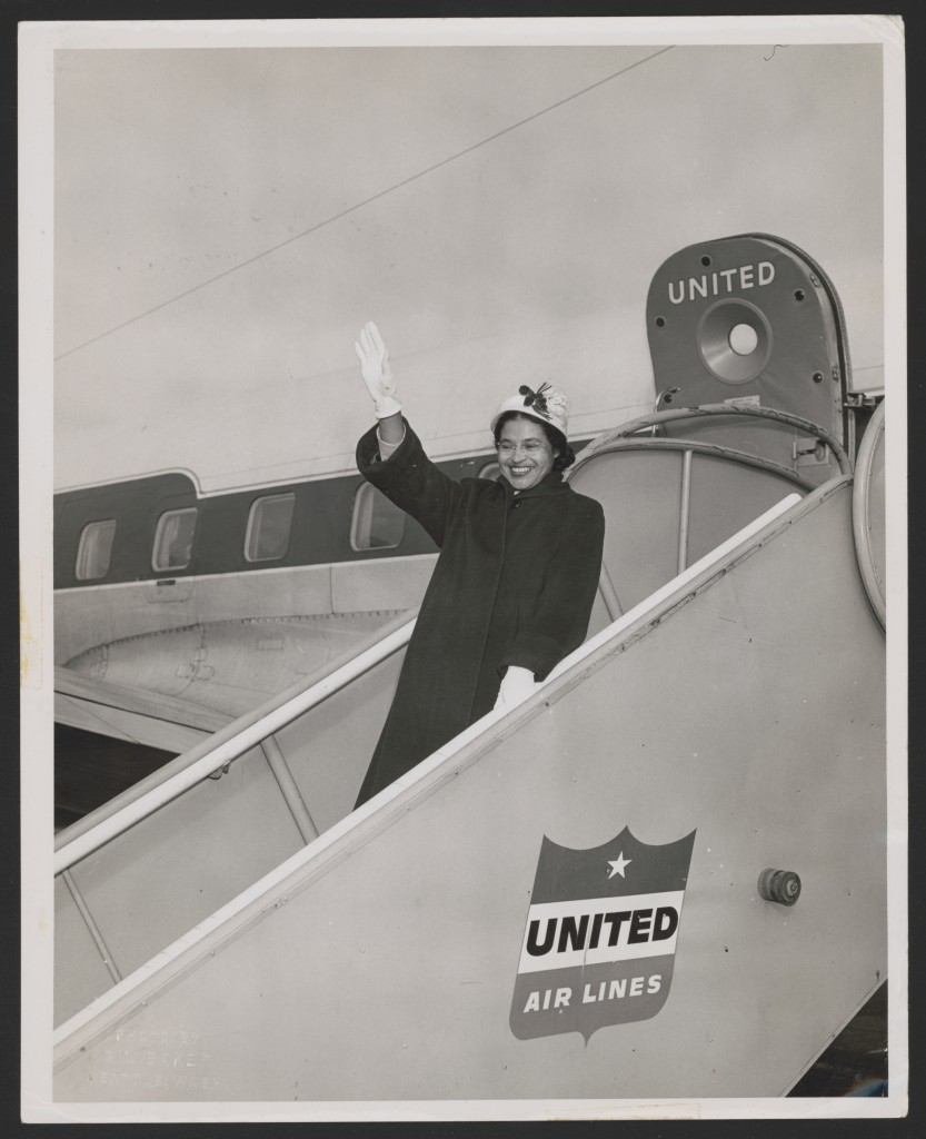Rosa Parks waving from a United Air Lines jetway in Seattle, Washington, 1956. Photograph by Gil Baker, courtesy of the Library of Congress.