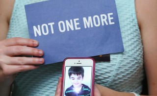 "WASHINGTON, DC - JUNE 17: Danielle Vabner holds a image of her little brother Noah Pozner who was shot and killed in the Newtown Ct. massacre,  during a news conference on gun safety, on June 17, 2014 in Washington, DC. Family members of gun violence victims announced the ""'Not One More' campaign urging American's to call on Congress to pass better gun safety laws.   Photo by Mark Wilson/Getty Images)  (Photo by Mark Wilson/Getty Images)"