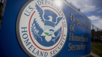 A U.S. Department of Homeland Security (DHS) sign stands at the headquarters in Washington, D.C., on Thursday, Dec. 11, 2014. Photo by Andrew Harrer/Bloomberg/Getty Images