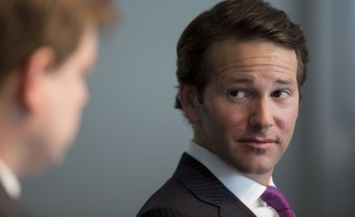 Representative Aaron Schock, R-Ill., during 2014 an interview in Washington, D.C. The Justice Department opened an investigation into Schock's House office expenses. Schock personally reimbursed $40,000 following a recent revelation that he used taxpayer funds for his lavish office decor. Photo by Andrew Harrer/Bloomberg via Getty Images