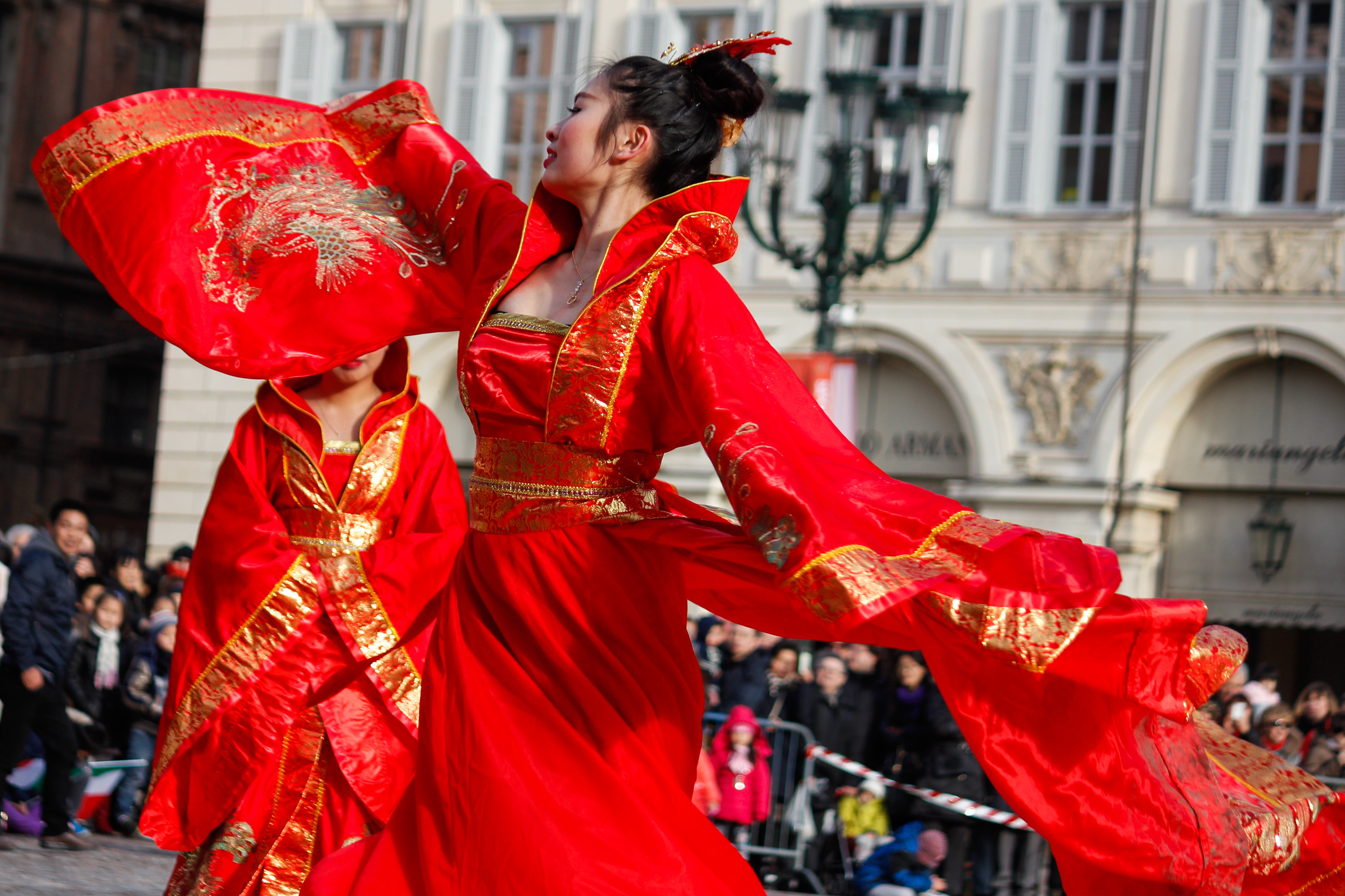 An artist dances in the streets of downtown Turin, Italy during the Festival of the Chinese New Year on February 8, 2015. Photo by Elena Aquila/Pacific Press/LightRocket via Getty Images.