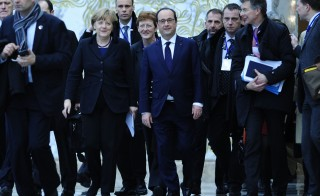 French President Francois Hollande (fourth from right) and German Chancellor Angela Merkel (left) attend talks over the crisis in Ukraine on Feb. 12 in Minsk, Belarus. The talks produced an agreement between Russia and Ukraine on bringing peace to eastern Ukraine. Photo by Sefa Karacan/Anadolu Agency/Getty Images