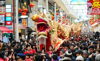 A dragon dance is performed at a shopping street in Kobe to promote the Chinese New Year on February 15, 2015 in Kobe, Hyogo, Japan. Photo by The Asahi Shimbun via Getty Images.