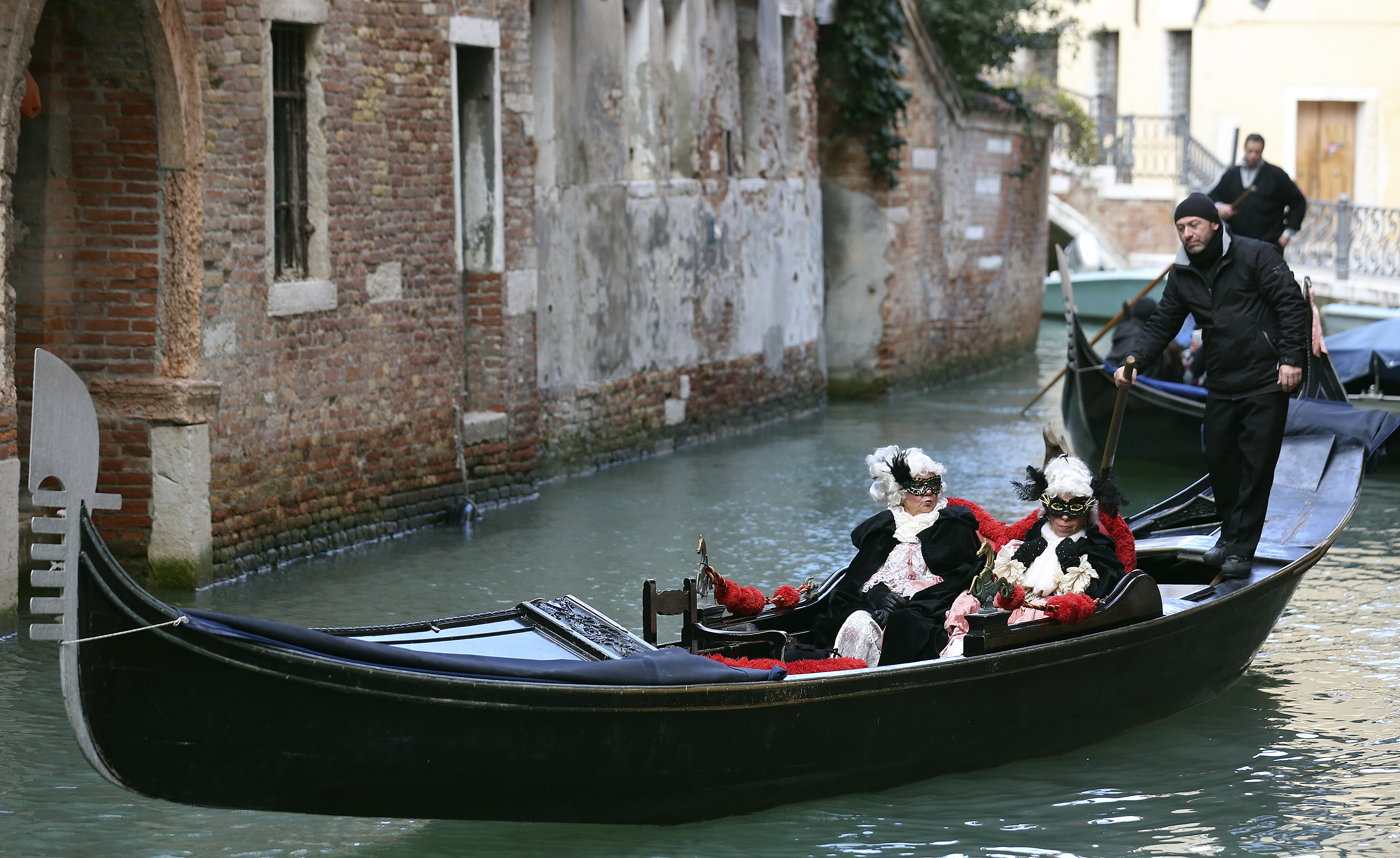 Masked revelers ride a gondola during the Venice Carnival, February 7, 2015. Photo by Stefano Rellandini/REUTERS.