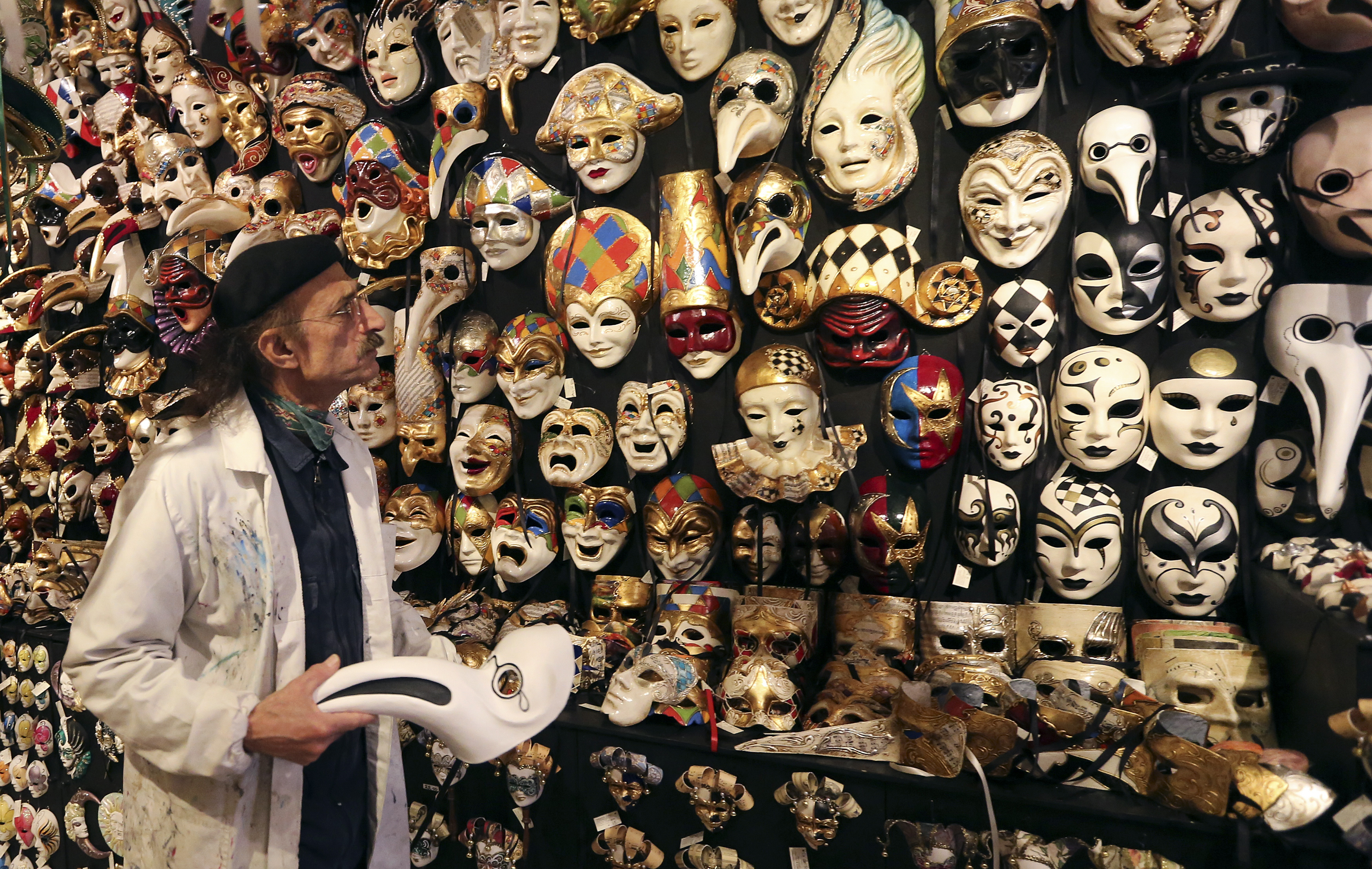 "Iranian mask artisan Hamid works in his shop ""Ca' del Sol"" near St. Mark's square during the first day of carnival in Venice February 1, 2015. Photo by Stefano Rellandini/REUTERS."
