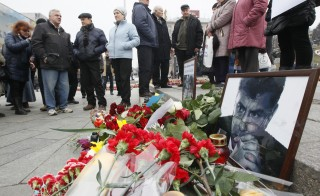 Photos, flowers and candles are left in memory of Boris Nemtsov, who was recently murdered in Moscow, in Independence Square in Kiev