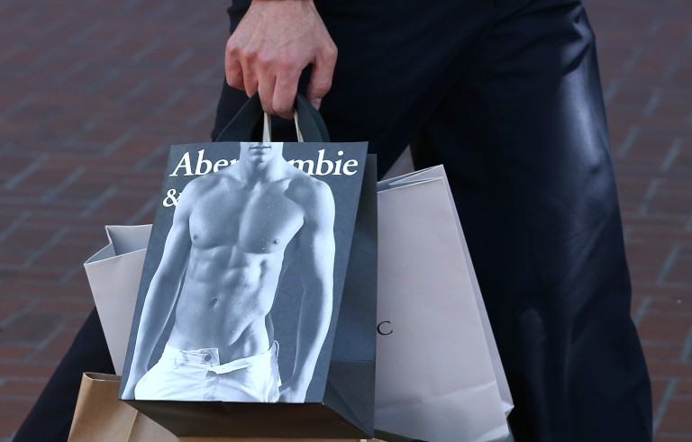 A pedestrian carries an Abercrombie and Fitch shopping bag on May 24, 2013 in San Francisco, California.  Teen apparel retailer Abercrombie and Fitch discriminated against a Muslim teenager who wore a headscarf to a job interview. Photo by Justin Sullivan/Getty Images