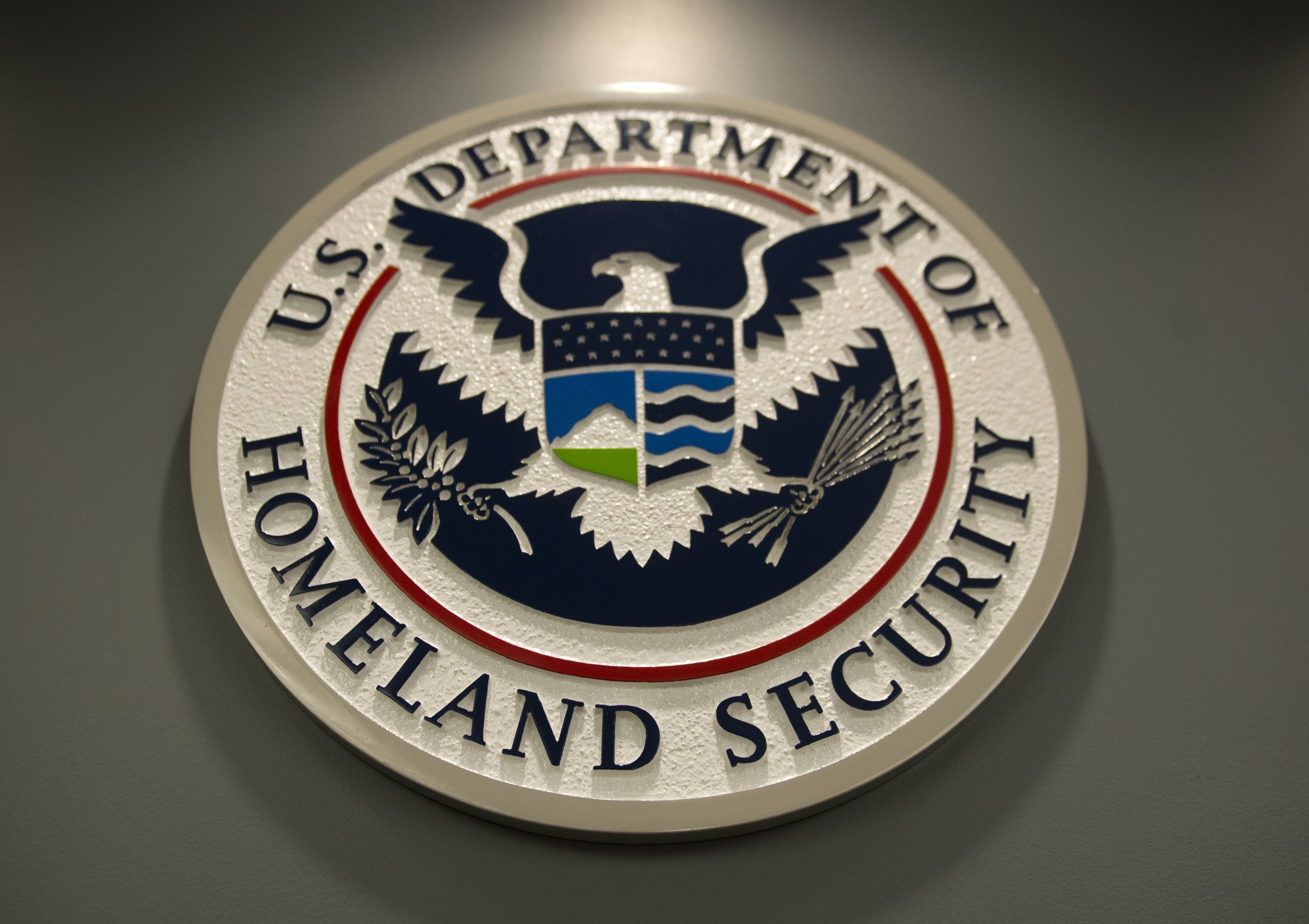 The logo of the Department of Homeland Security is seen at US Immigration and Customs Enforcement in Washington, DC, February 25, 2015. House democrats see the GOP's security strategy as a political blunder. Photo by Saul Loeb/AFP/Getty Images.
