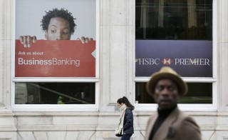Pedestrians walk past an HSBC bank in London, February 9, 2015. HSBC published an apology Sunday in response to media reports it helped wealthy customers dodge taxes and conceal millions of dollars of assets. Photo by Suzanne Plunkett/Reuters