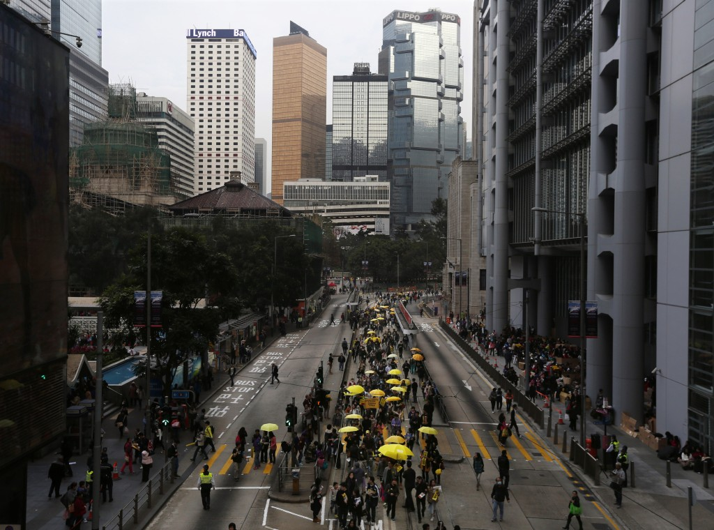 Protesters carrying the yellow umbrellas that have become symbolic of the pro-democracy movement march in Hong Kong February 1, 2015. The demonstration was the first since police dismantled protest camps in December. Photo by Bobby Yip/Reuters.