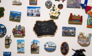 Michael McDonnell and his wife adorned their refrigerator with magnets from various cities around the world and an extraterrestrial reminder of Michaels dream to join a one-way mission to Mars. Photo by Eric Krupke/NewsHour