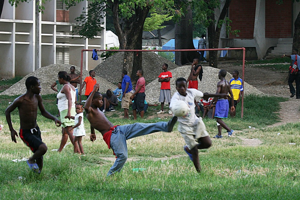 Soccer break Outside the Doctor's WIthout Borders hospital, an informal camp has covered the fields, but the residents left this area open for soccer games.