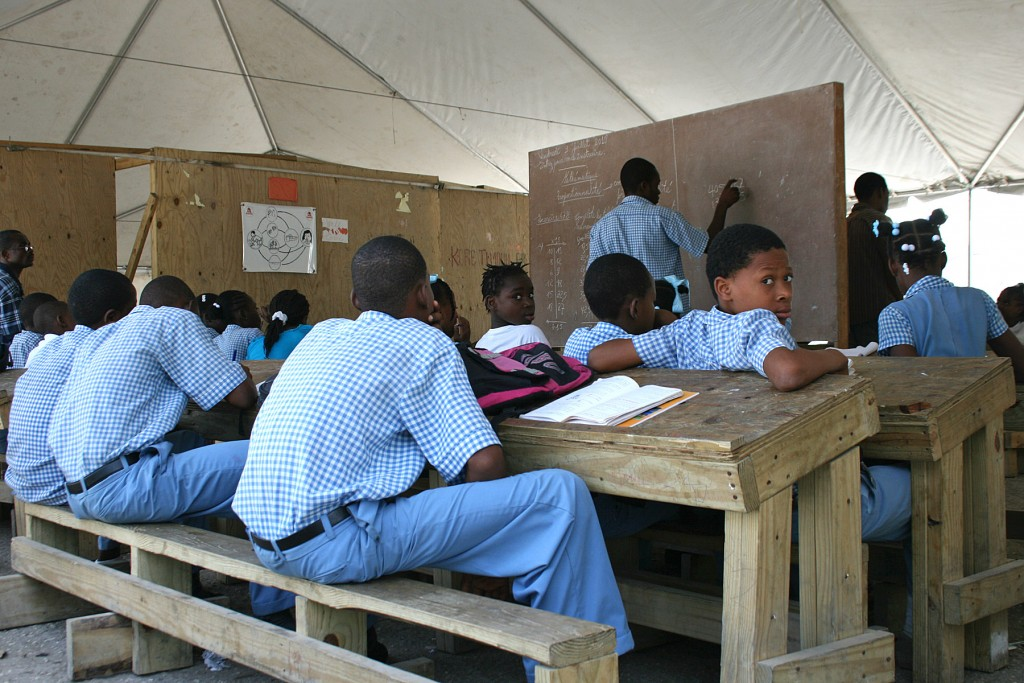 School in the tent city Students can attend class at a large school tent on Dadadou property, though camp organizers estimate only a fraction of children there do go to class.