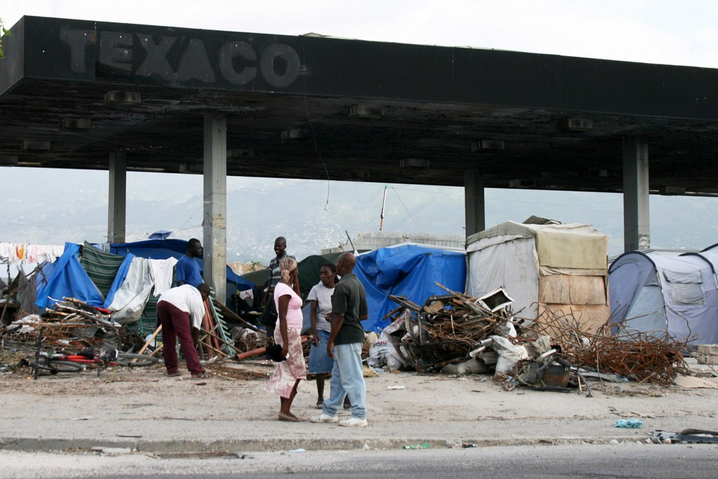 Shelter at a gas station Protection from the rain is crucial for people living in the tent camps now that Haiti has entered hurricane season.