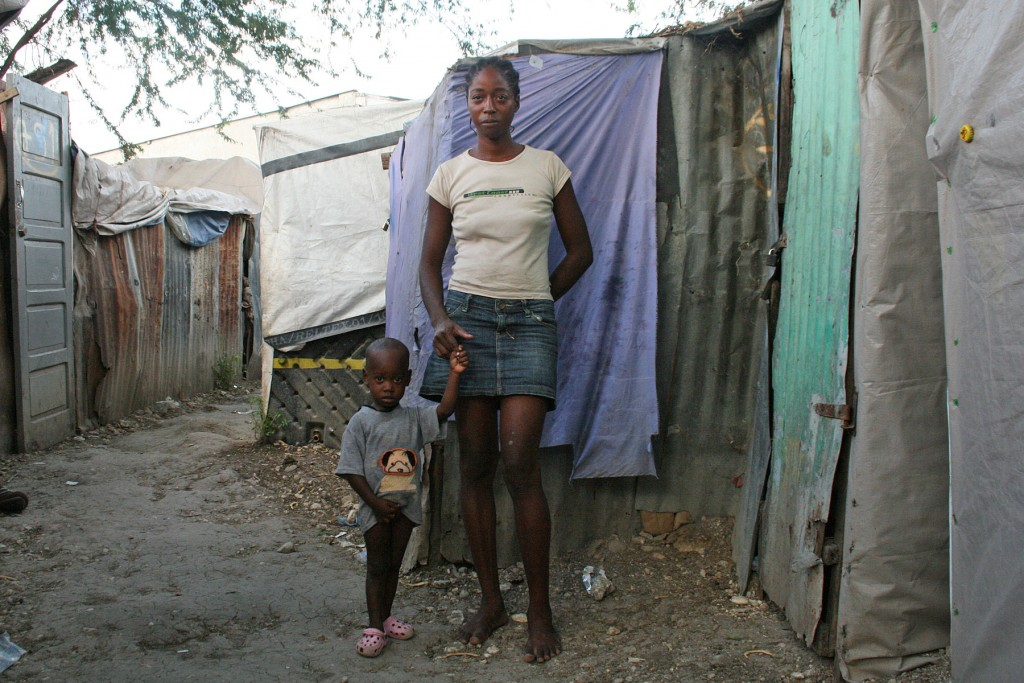 "'It is awful, I do nothing' Iviana Frederique lost her small merchant business in the earthquake and now spends her days sitting around her camp. ""It is awful, I do nothing,"" she said."