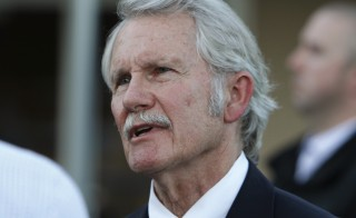 Oregon Governor John Kitzhaber attends a vigil after a school shooting in Troutdale, Oregon June 10, 2014. Federal investigators have subpoenaed documents related to an influence-peddling scandal that led the four-term governor to announce his resignation Friday. Photo by Steve Dipaola/Reuters